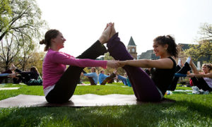 Yoga instructor Emma Seppala, left and wearing pink, and undergraduate Kimberly Helton lead other participants in stretching their bodies and refreshing their minds under the morning sun on Bascom Hill at the University of Wisconsin-Madison during spring on April 19, 2010. The class, called Sun Salutation on Bascom, is one of several featured events during the Wisconsin Alumni Student Board (WASB)-sponsored All-Campus Party held April 17-23, 2010. Seppala is an instructor with the student group, Yoga, Empowerment, and Service; and a postdoctoral student in the Center for Investigating Healthy Minds. ©UW-Madison University Communications 608/262-0067 Photo by: Jeff Miller Date: 04/10 File#: NIKON D3 digital frame 9757