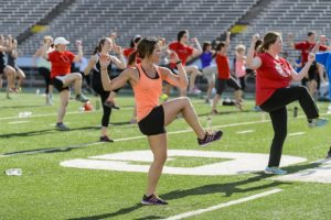With UW mascot Bucky Badger leading them, members of the UW-Madison community participate in Bucky's Workout, a collaborative event hosted by UW Athletics, Rec Sport, Human Resources and UWell at Camp Randall Stadium on May 27, 2015. The hour-long event was open to all fitness levels and designed to celebrate the beginning of summer and being active. (Photo by Bryce Richter / UW-Madison)
