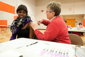Student Kemi Olarinde (left) receives a H1N1 influenza vaccination from University Health Services (UHS) nurse Marsha Steffen (right) during the H1N1 FlashVax clinic held Dec. 4, 2009 at the Southeast Recreational Facility (SERF) at the University of Wisconsin-Madison. ©UW-Madison University Communications 608/262-0067 Photo by: Bryce Richter Date: 12/09 File#: NIKON D3 digital frame 4395