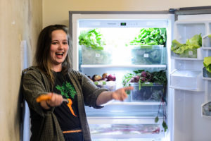 Undergraduate student Hannah DePorter officially welcomes people to help themselves to refrigerator-stored produce during the grand opening of the UW Campus Food Shed at 333 East Campus Mall at the University of Wisconsin-Madison on June 16, 2017. The unique project, started by DePorter with the help of a $5,000 Kemper K. Knapp Bequest grant, aims to redirect some of the surplus produce from several of UW-Madison's agricultural research endeavors, and freely provide the vegetables and produce to UW students, faculty and staff via one of four distribution locations on campus. (Photo by Jeff Miller/UW-Madison)